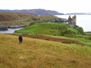 Romantic image of a ruined castle on a rugged coast.