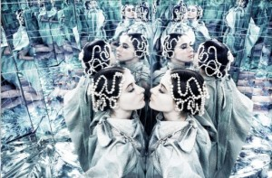 Repeating mirror images of a woman