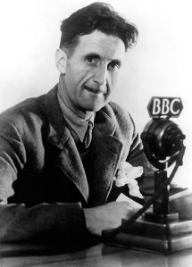 George Orwell sitting at a BBC microphone