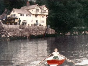 Daphne du Maurier rowing near her old house at Ferryside